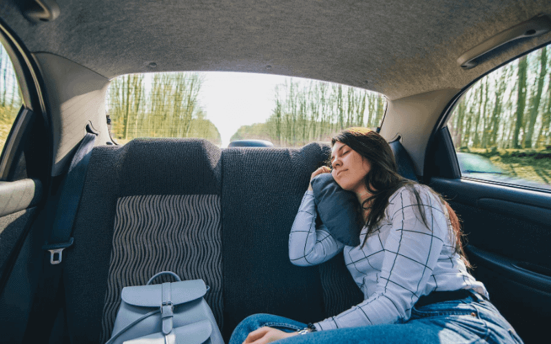 How To Sleep Comfortably In The Backseat Of A Car