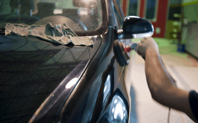 how to wax a black car with scratches